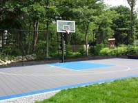 Titanium and light blue backyard basketball court in West Bridgewater, MA.