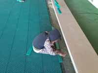 Resurfaced ABBA (Antigua and Barbuda Basketball Association) basketball court and replaced hoops at JSC Sports Complex in Piggotts, Antigua and Barbuda. Youngster getting involved in finishing touches on new court tiles.
