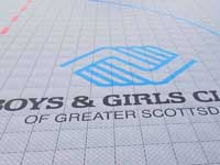 Closeup of logo for Boys & Girls Clubs of Greater Scottsdale, AZ, on inline hockey rink.