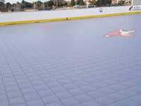 Photo from Scottsdale, Arizona installation of inline skating hockey rink for NHL Coyotes and the Boys & Girls Club, at Laguna Elementary. Removal of old surface, prep, installation of Versacourt IceCourt Outdoor Speed tile, and finished surface with custom logos.