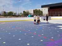 Installation of court tiles in progress on newly built inline hockey rink at Grand Canyon University in Phoenix, AZ. Logo for GCU Antelopes in foreground and Arizona Coyotes in background, especially if you click for the larger image.