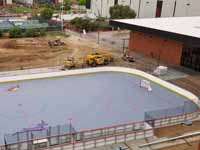 Rooftop view of right end of newly built and surfaced outdoor inline hockey court for Grand Canyon University in Phoenix, AZ.