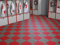 This sample picture shows red and grey tile installed in a locker room. The tile allows water to flow through to the concrete floor below.